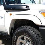 TJM   FRONT FLARE DELUXE FIBREGLASS BLACK PAIR   LC 70 SERIES V8 2007+